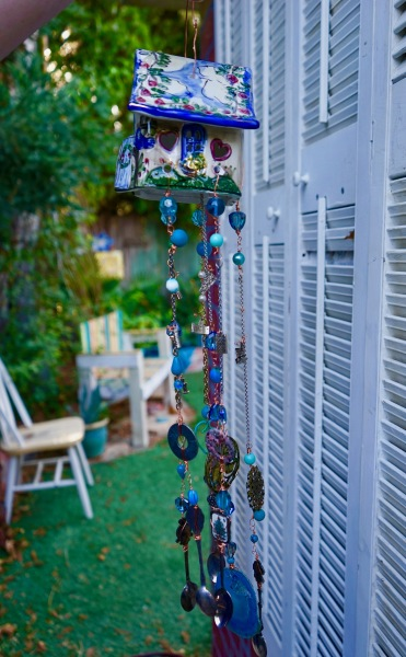 Side view of ceramic house wind chim
