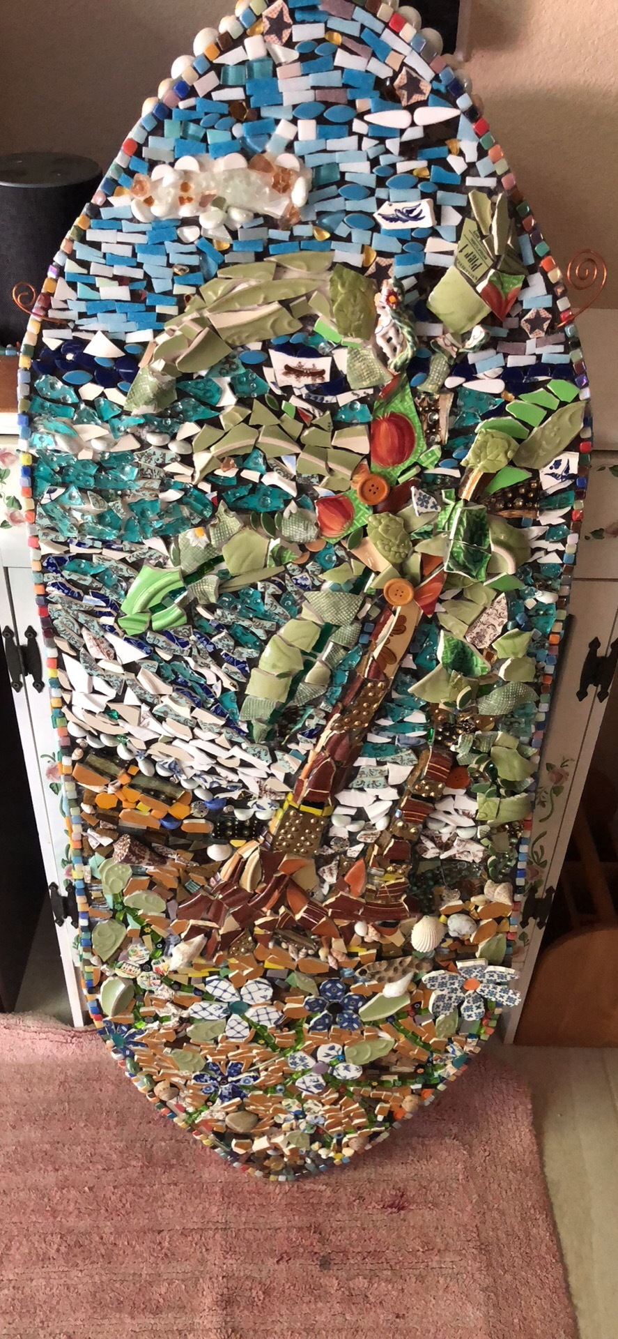 The surfboard project... a mosaic made with plates, cups and dishes!